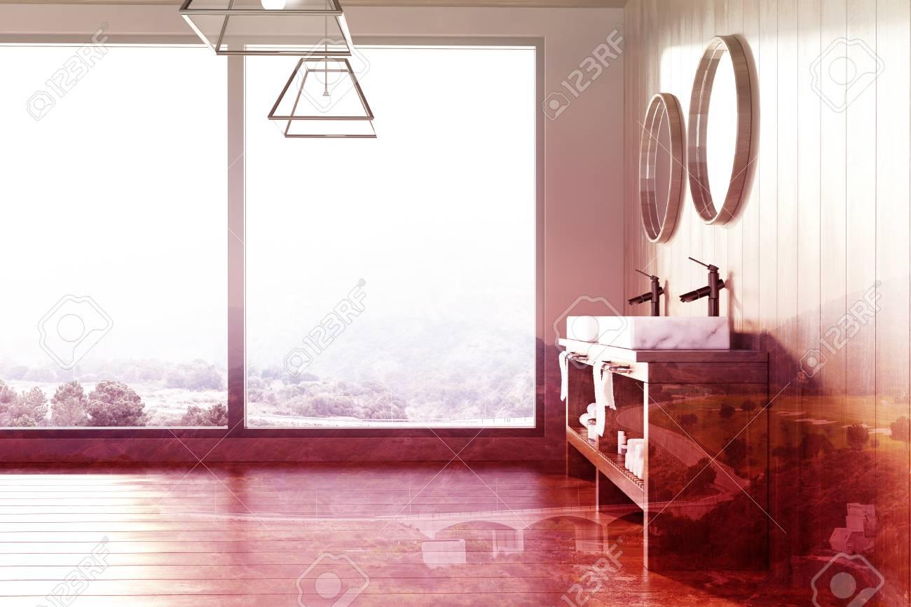 Espejos Redondos Lavabo.Interior Moderno Del Bano Con Suelo Y Paredes De Madera Y Un Lavabo Doble De Marmol Dos Espejos Redondos Y Una Ventana Abuhardillada Representacion