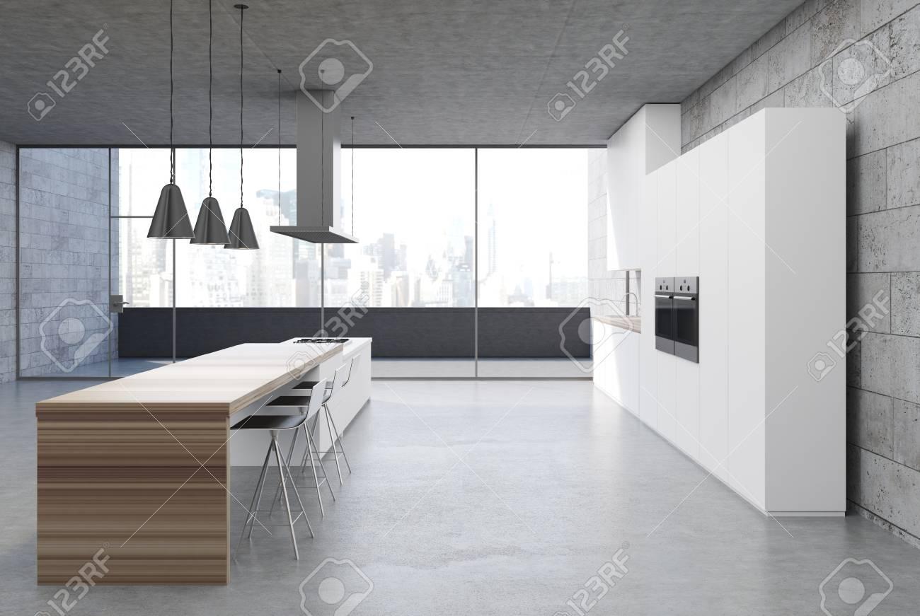 Concrete kitchen interior with a concrete floor, white cabinets..