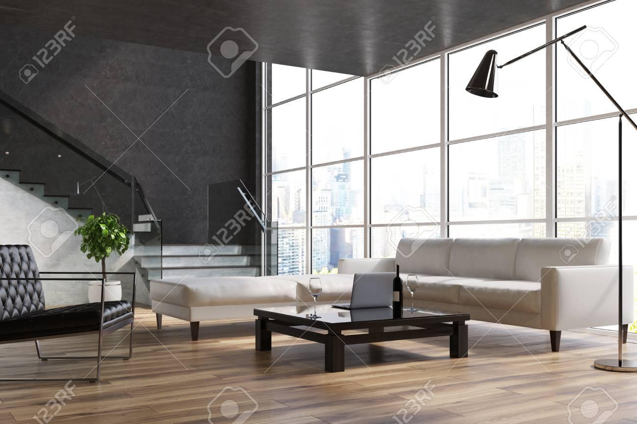 schwarzer wohnzimmerinnenraum mit einem hölzernen fußboden, einem