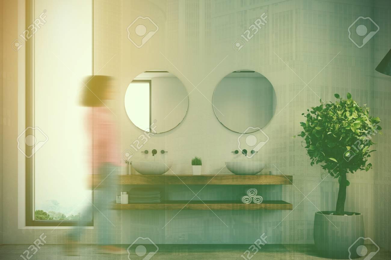 Woman In A Narrow Window Bathroom Interior With A Concrete Floor ...