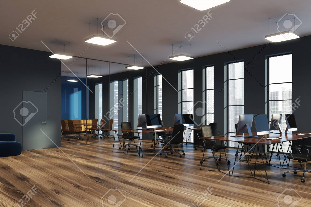 Espace de bureau espace ouvert avec des murs gris et en verre un