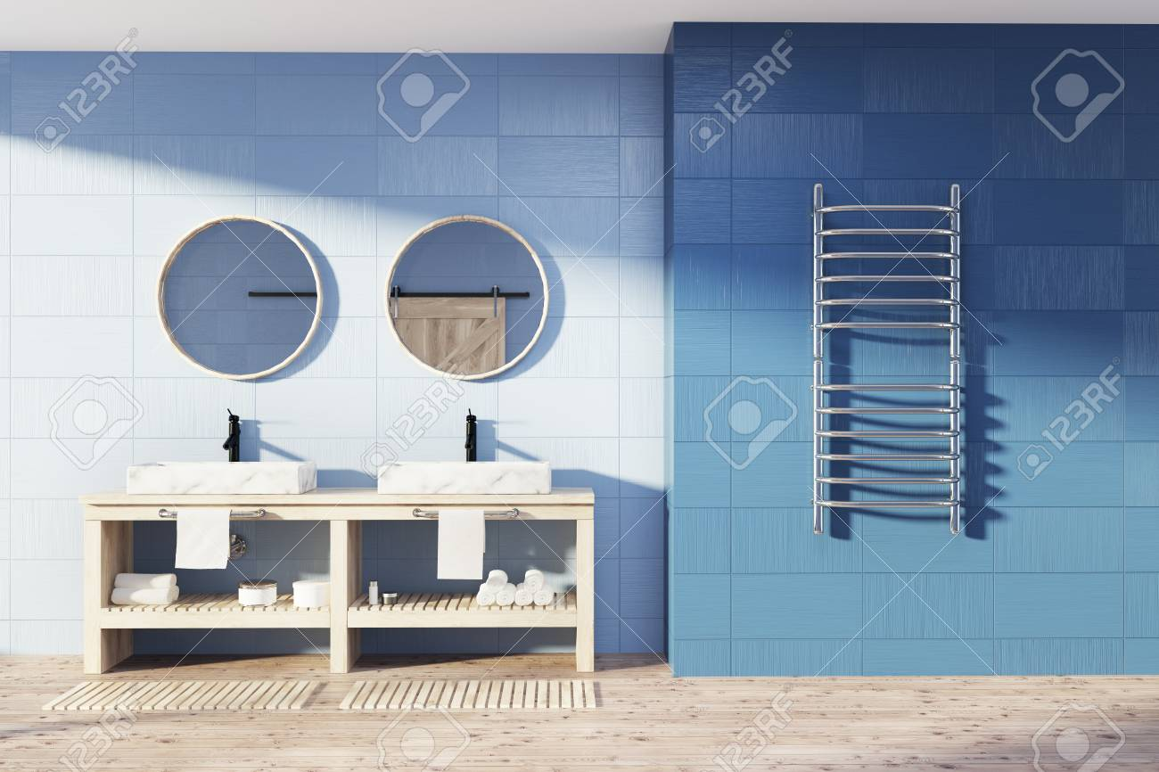 Blue Bathroom Interior With A Wooden Floor, A Double Sink With ...