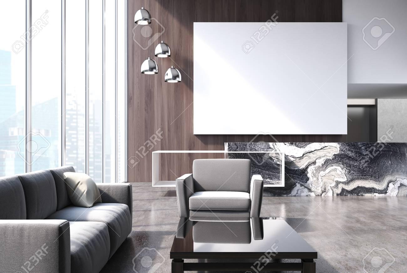 Intérieur d\'un salon en bois avec un sol en béton, des canapés gris près  d\'une table basse ronde et une affiche. Maquette 3D