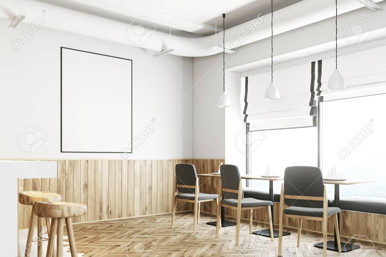 Interno bar bianco con pavimento bianco e legno un lungo bancone
