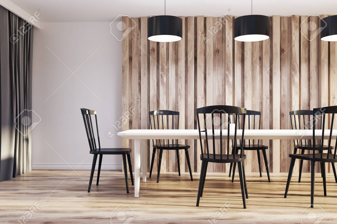 Table A Manger Originale white and wooden dining room interior with a long wooden table,..