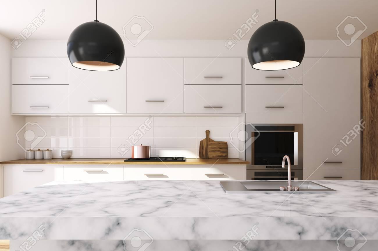 Interior blanco de la cocina con ventanas grandes, una mesa de mármol  blanco y una encimera de mármol blanco con un fregadero. Representación 3D