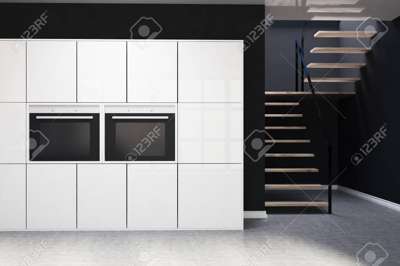 Black Kitchen Interior With A Concrete Floor White Cupboards