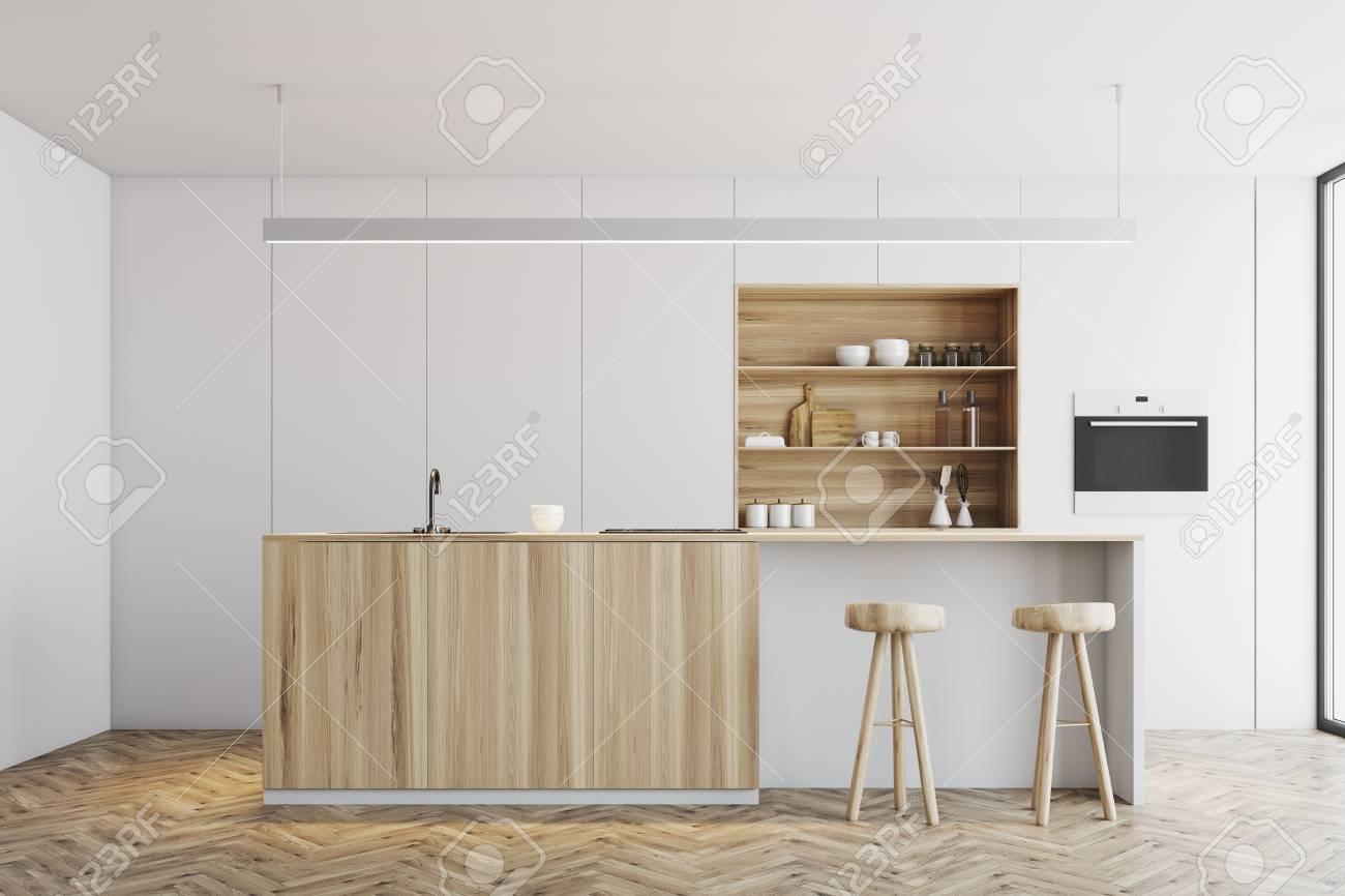 Cuisine Blanche Et Bois Clair intérieur de cuisine blanc avec un plancher en bois, un bar en bois clair  avec des chaises et des placards blancs en arrière-plan. maquette 3d