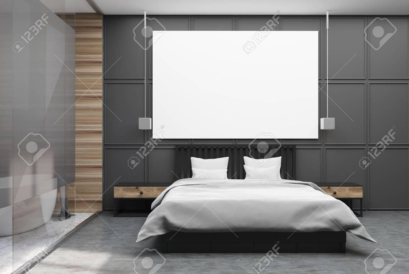 Interno camera da letto con pareti grigie e in legno, un pavimento in  cemento, un letto matrimoniale con una copertina bianca e due comodini. Un  ...