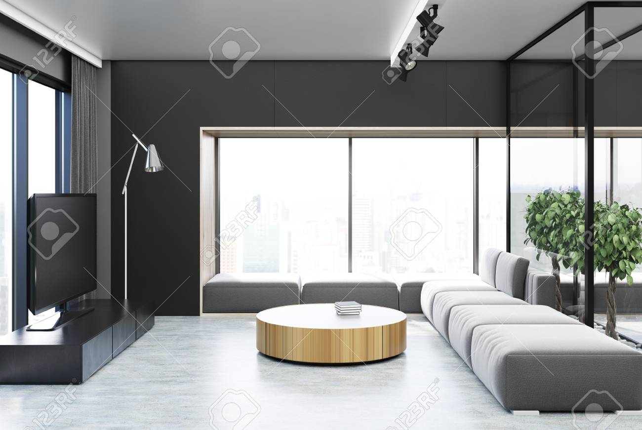 Black Living Room Interior With A Glass Wall, A Concrete Floor ...
