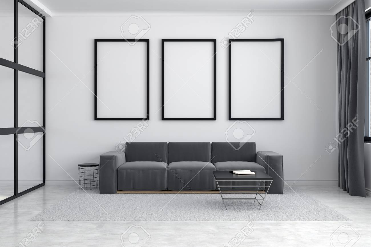 White Living Room Interior With A Long Sofa Standing Under Three ...