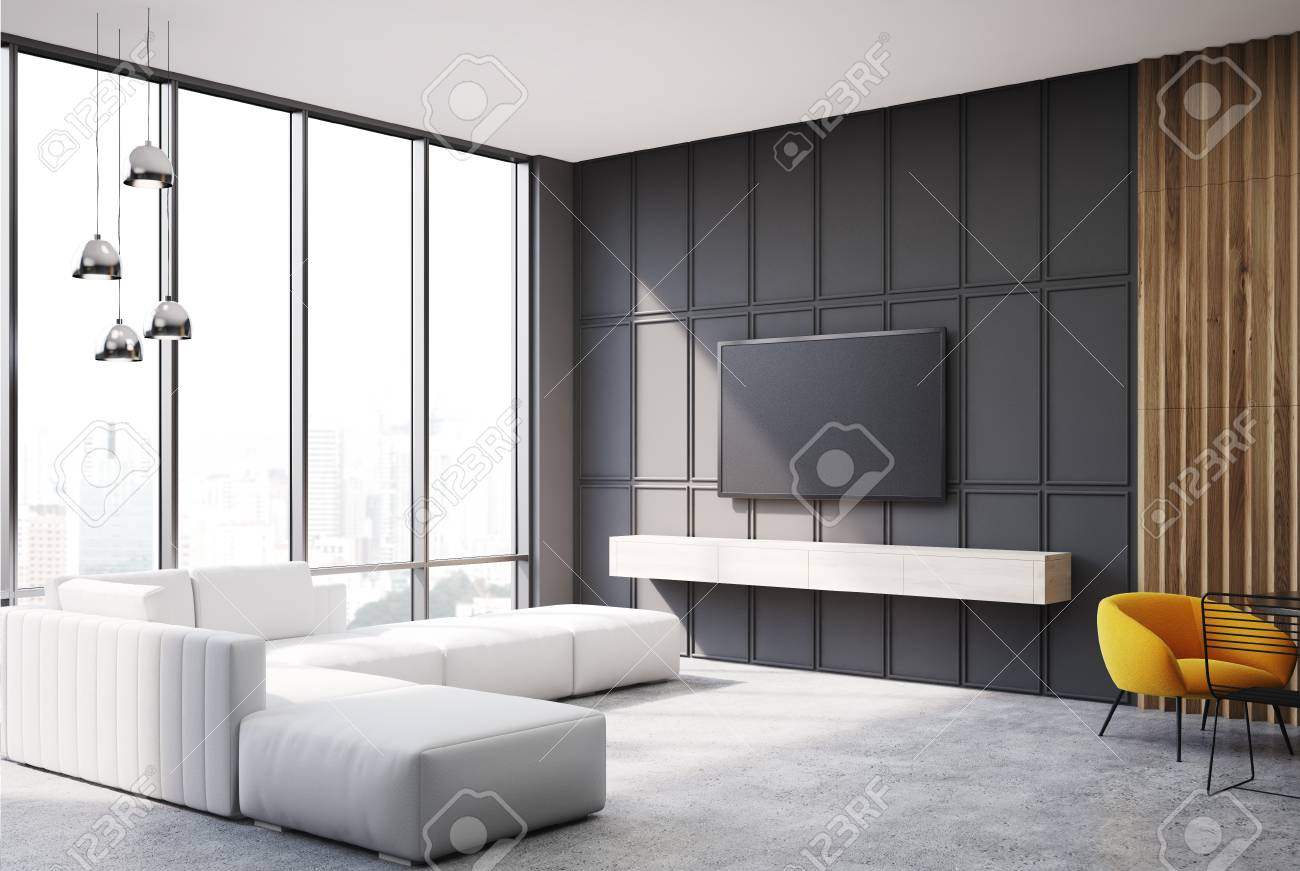 Gray And Wooden Living Room Corner With A TV Set Hanging On The Wall And A