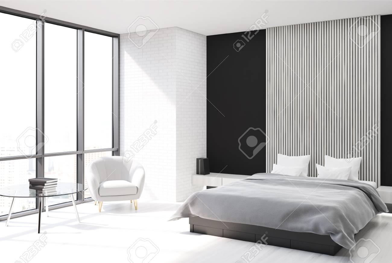Intérieur De Chambre à Coucher Moderne Avec Des Murs Noirs, En Bois Et En  Bois, Un Sol En Béton Et Un Lit De Maître Avec Une Affiche Verticale  Suspendue ...