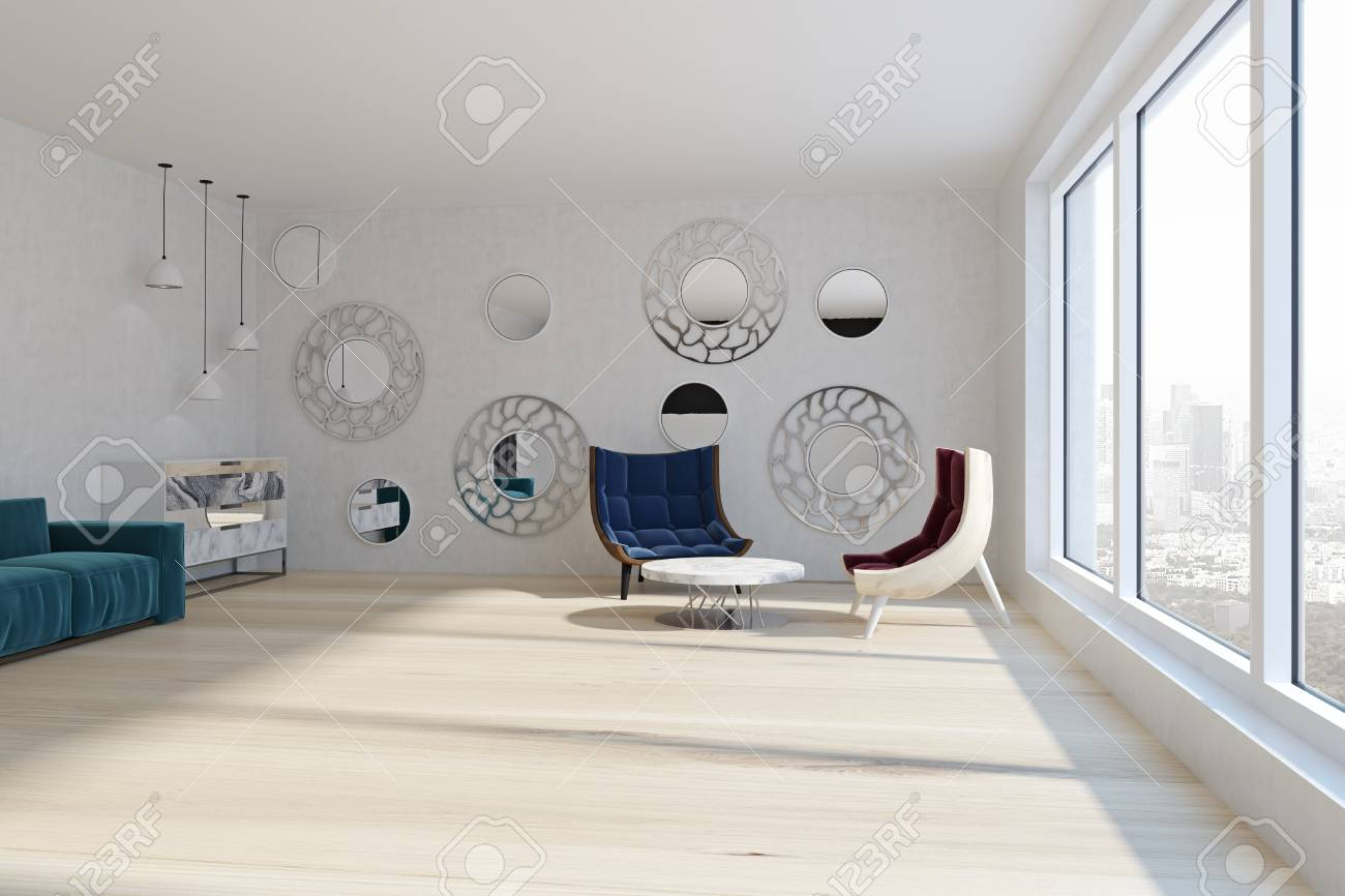 Red and blue armchairs in modern living room with round mirrors..