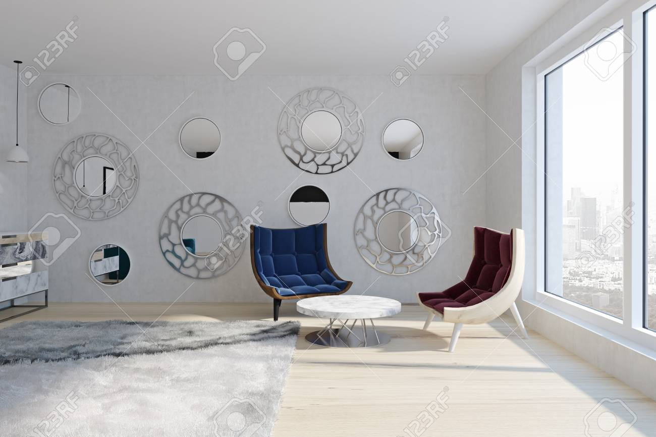 Red And Blue Armchairs In Modern Living Room With Round Mirrors