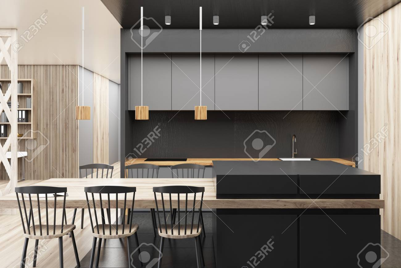 Black and wooden kitchen with a gray bar, a long table with chairs..