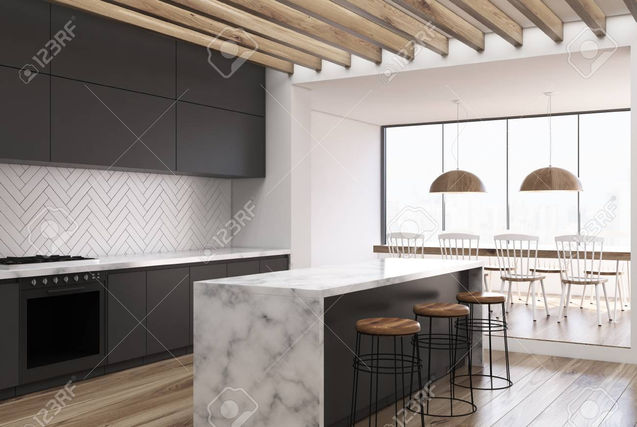 Side View Of A White Wooden Kitchen With A White Marble Bar Stock Photo Picture And Royalty Free Image Image 91305680
