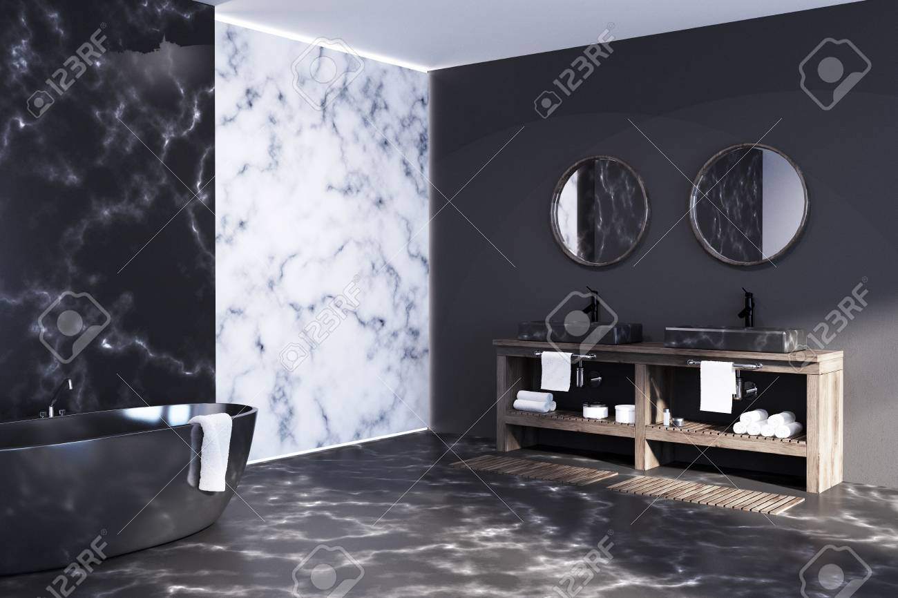 White And Black Marble Bathroom With A Black Tub Standing On Stock Photo Picture And Royalty Free Image Image 91305566
