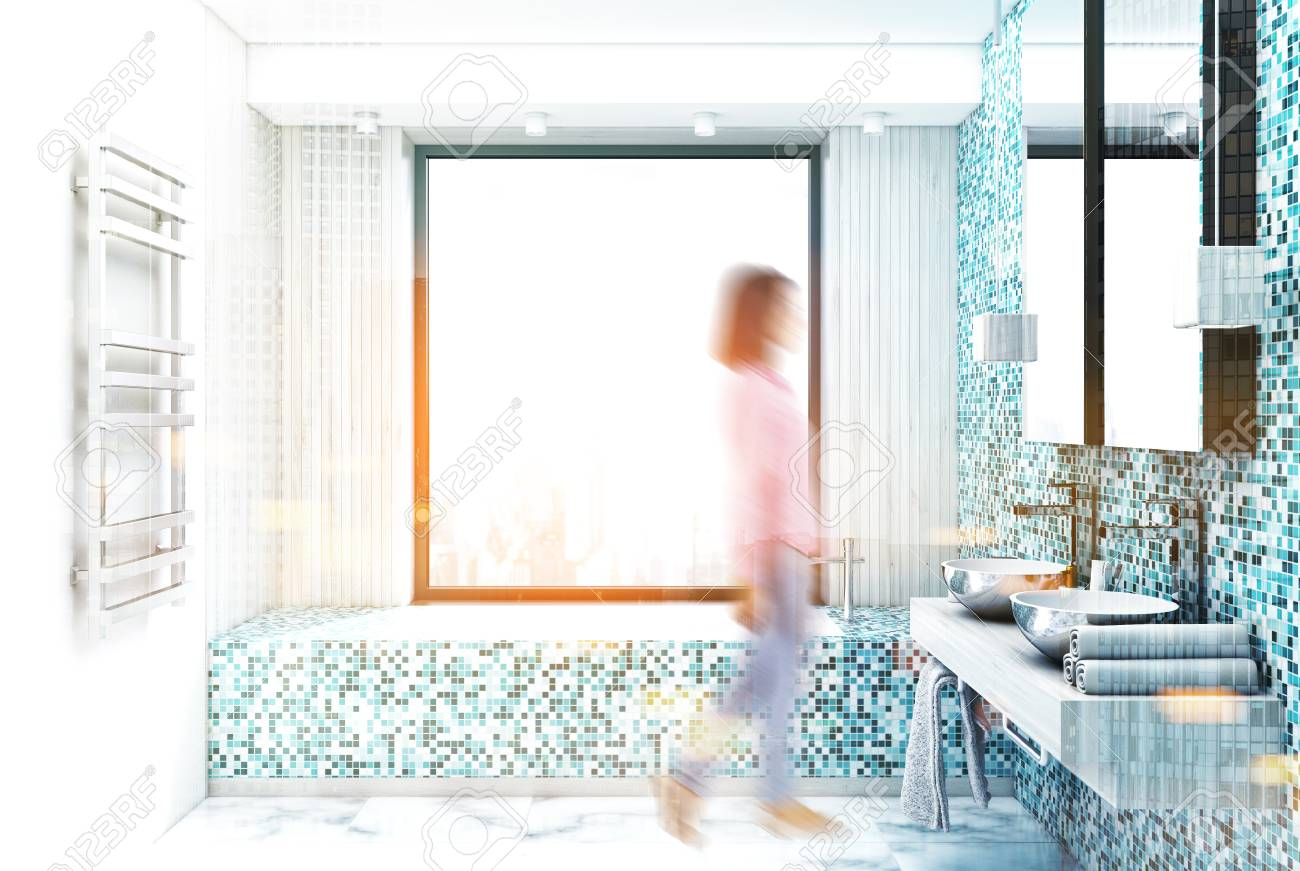 Woman In A Blue Tile Bathroom Interior With A Marble Floor, A ...