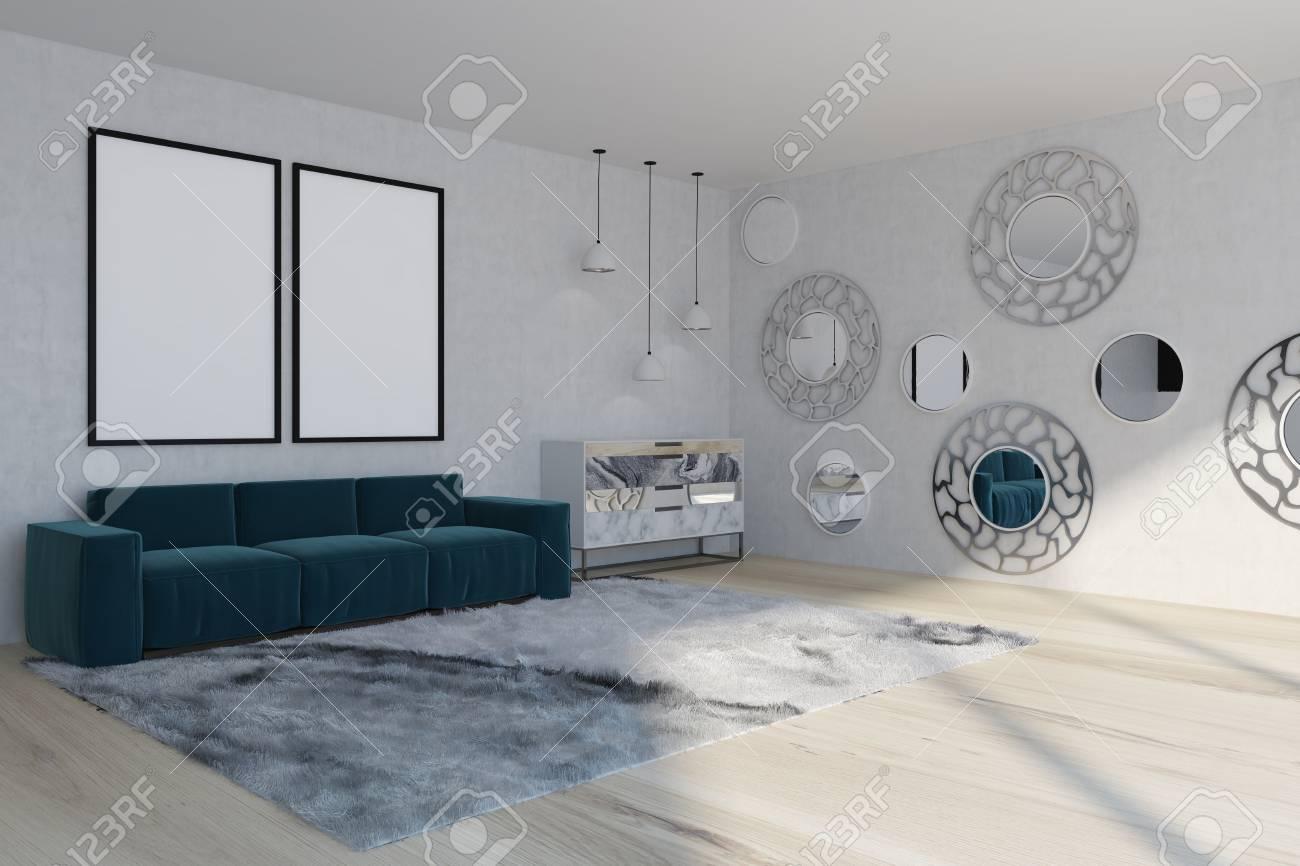 Miroir Au Dessus Canapé intérieur de salon blanc avec un tapis moelleux, un canapé bleu avec