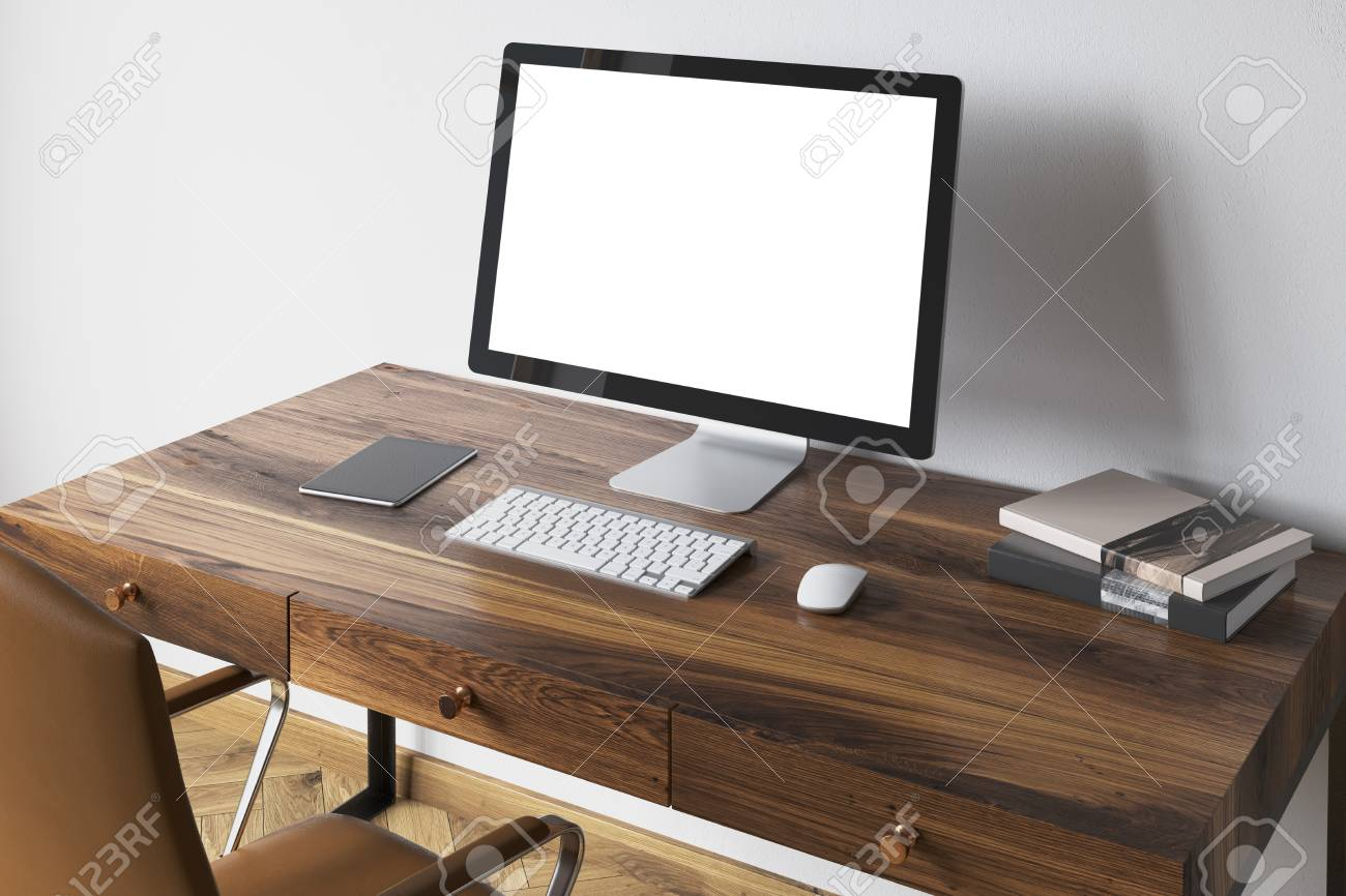 White Computer Screen Standing On A Dark Wooden Desk In A Modern Stock Photo Picture And Royalty Free Image Image 92787837
