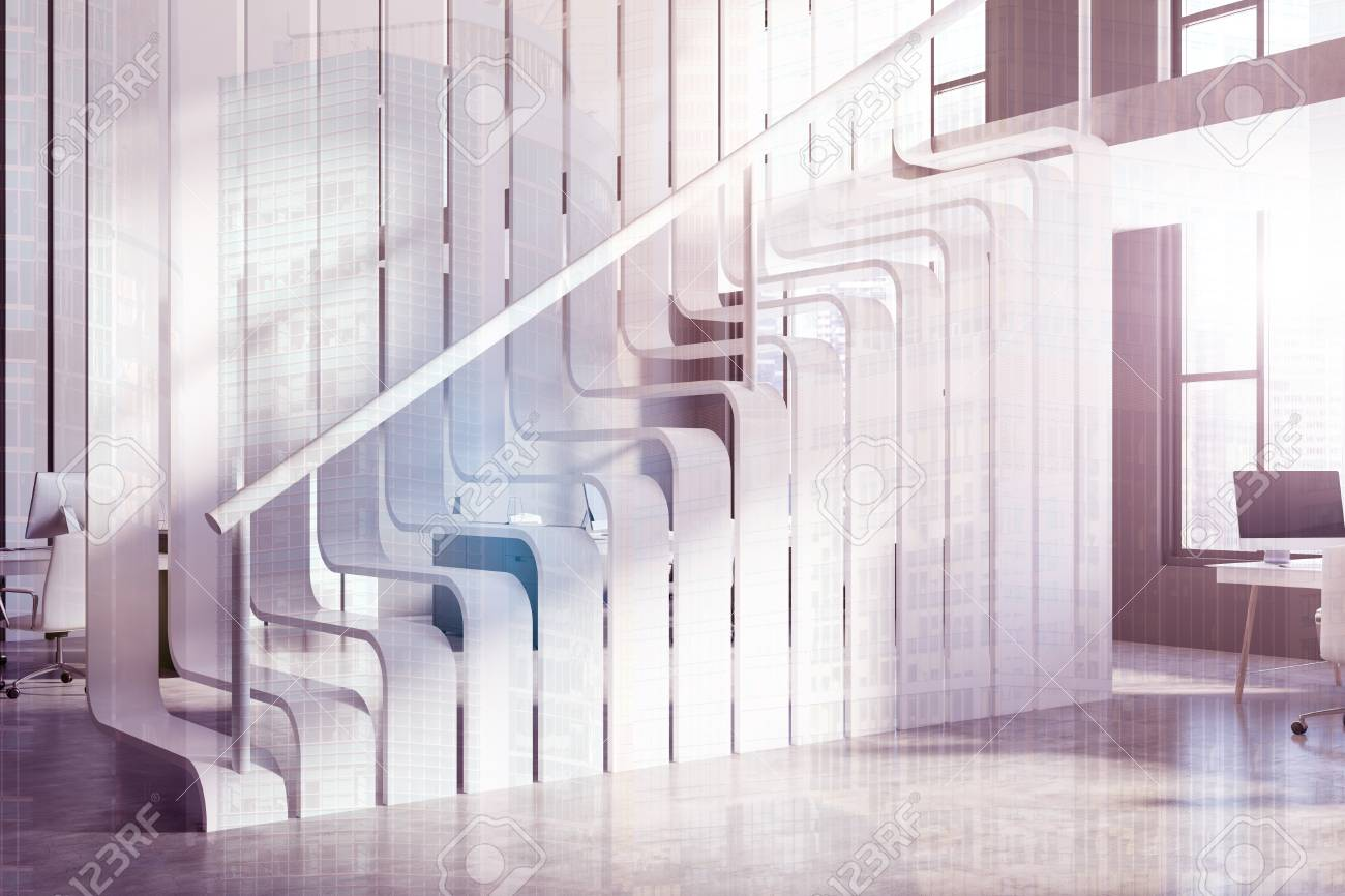 Original modern white staircase in a white office with computer..