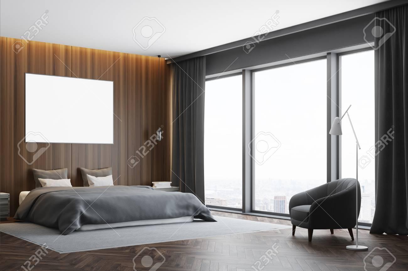 coin chambre en bois sombre avec un plancher en bois, un lit de