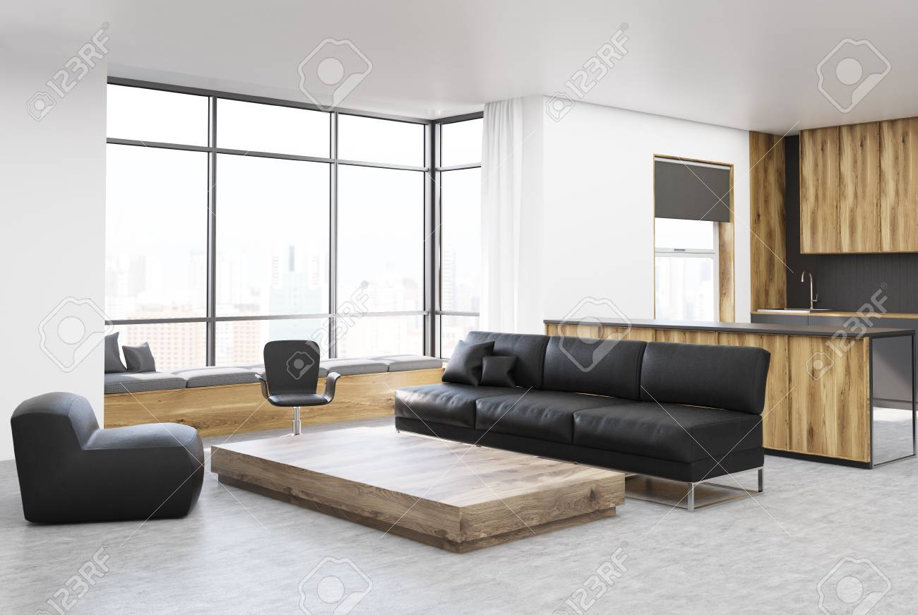 White and wooden living room corner with a black sofa, a wooden..