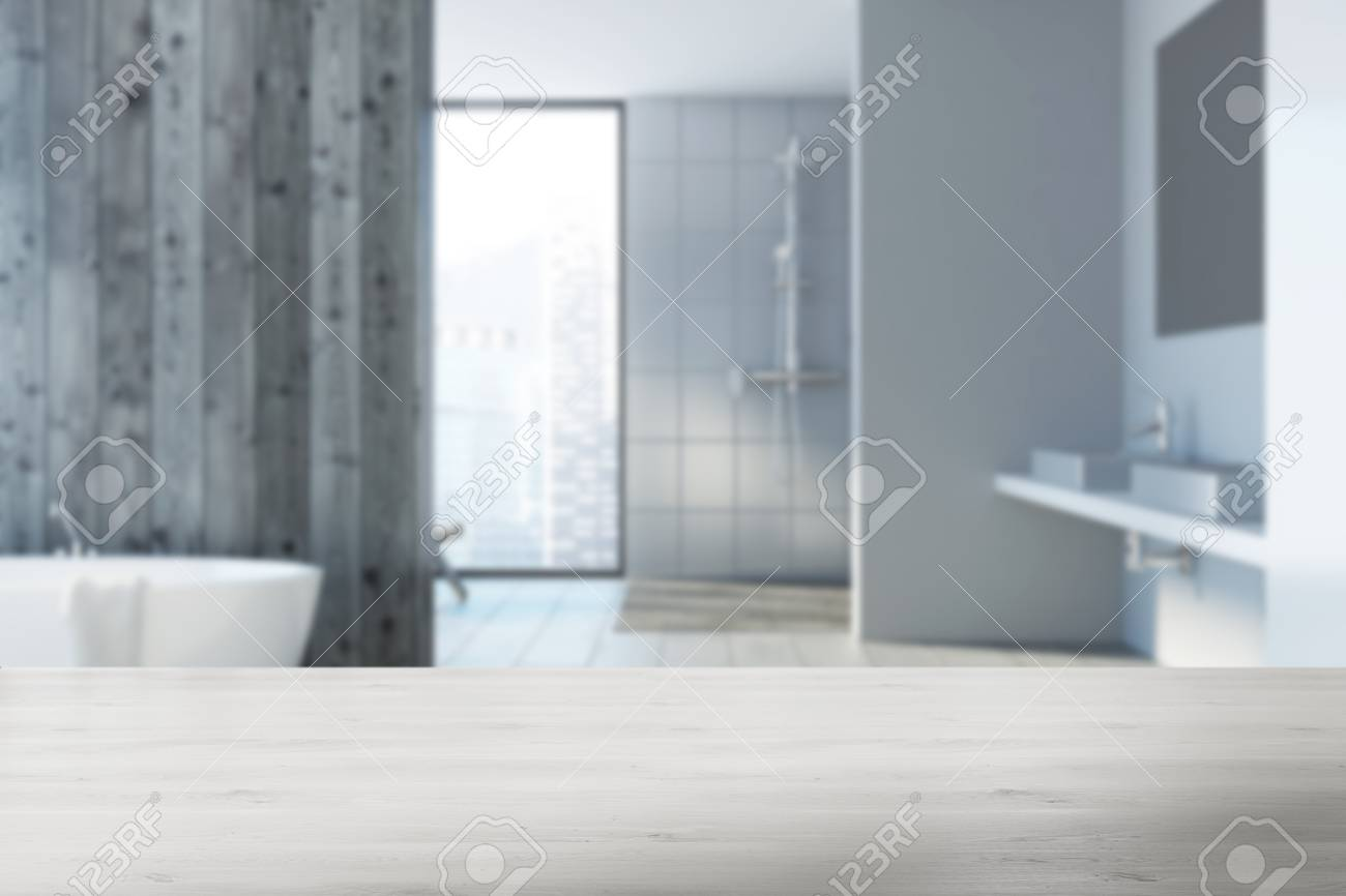 White Bathroom Corner With A Tiled Floor, A White Tub, A Shower ...
