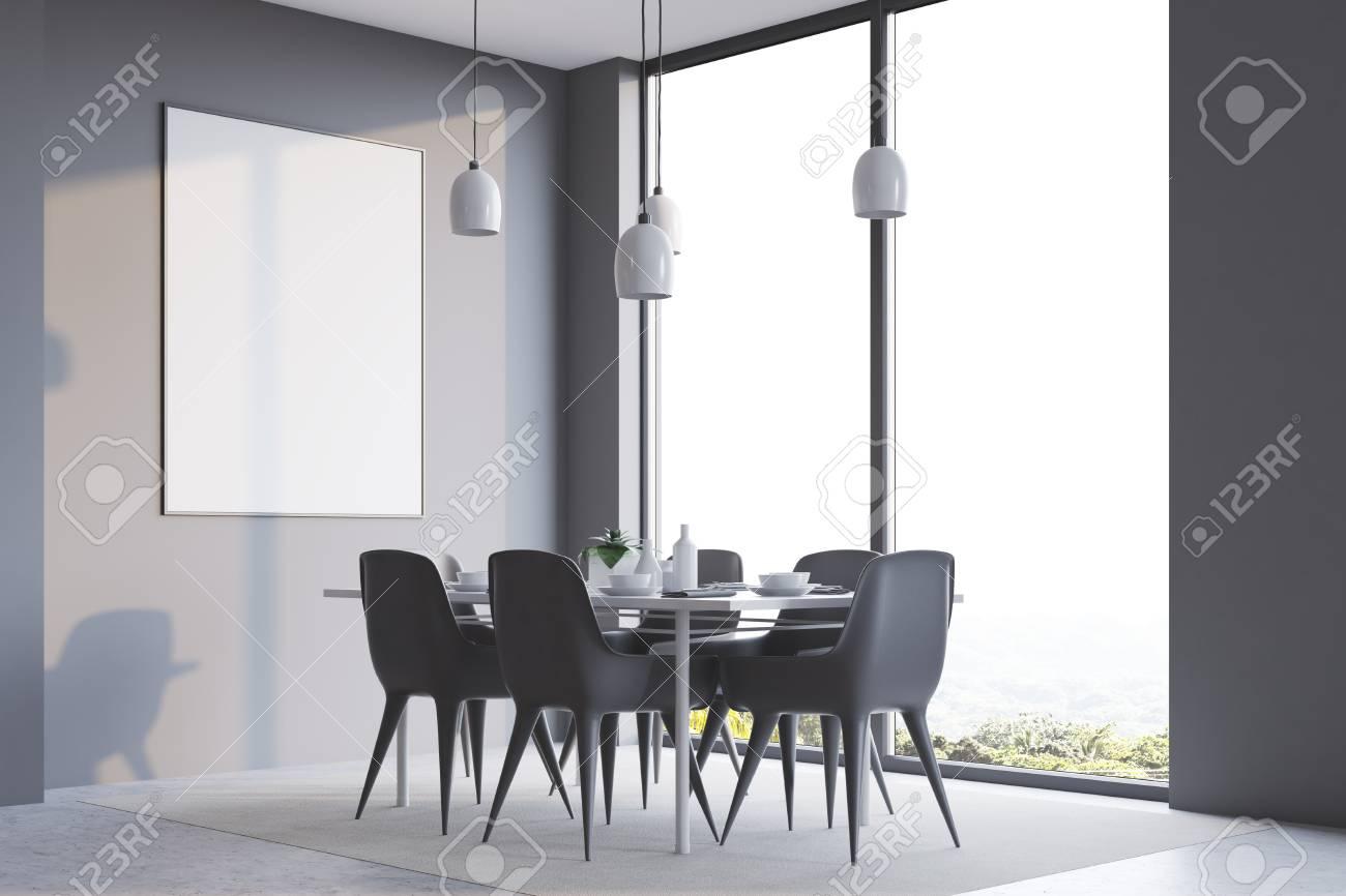 Esquina de comedor minimalista gris con una larga mesa blanca, sillas  grises y un póster vertical enmarcado. Representación 3D imitan para arriba