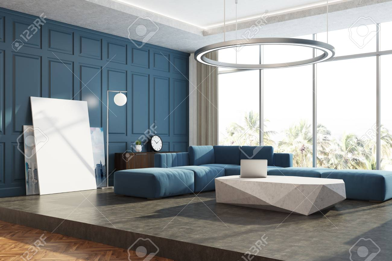 Modern living room corner with blue walls, a concrete floor,..
