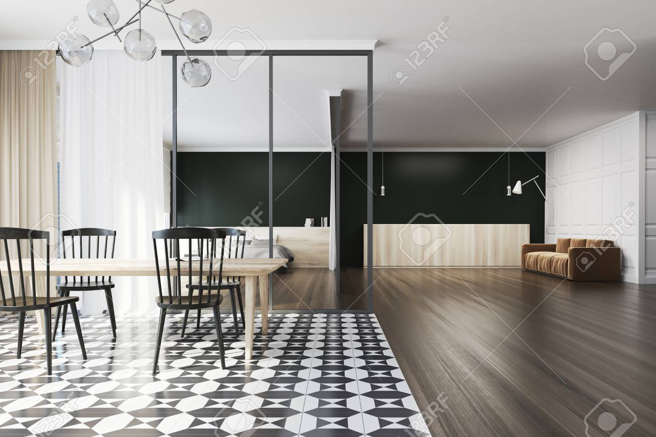 Black dining room interior with a wooden table with black chairs...