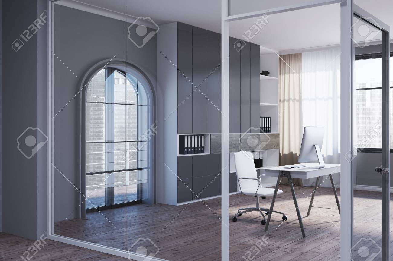 Corner Of A Manager S Office With Gray And Glass Walls A Wooden