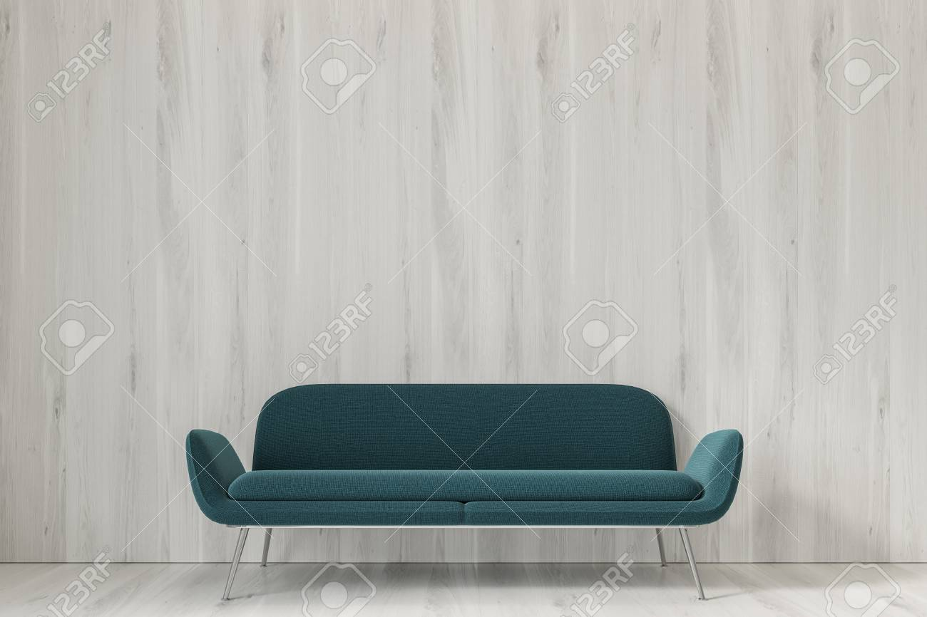 White empty room interior with a dark green sofa standing on..