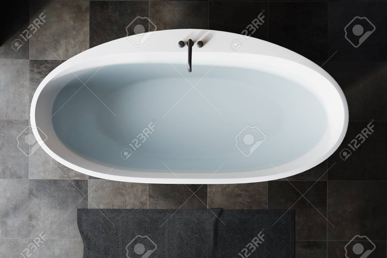 Top View Of A White Bath Tub Filled With Clear Water Standing ...