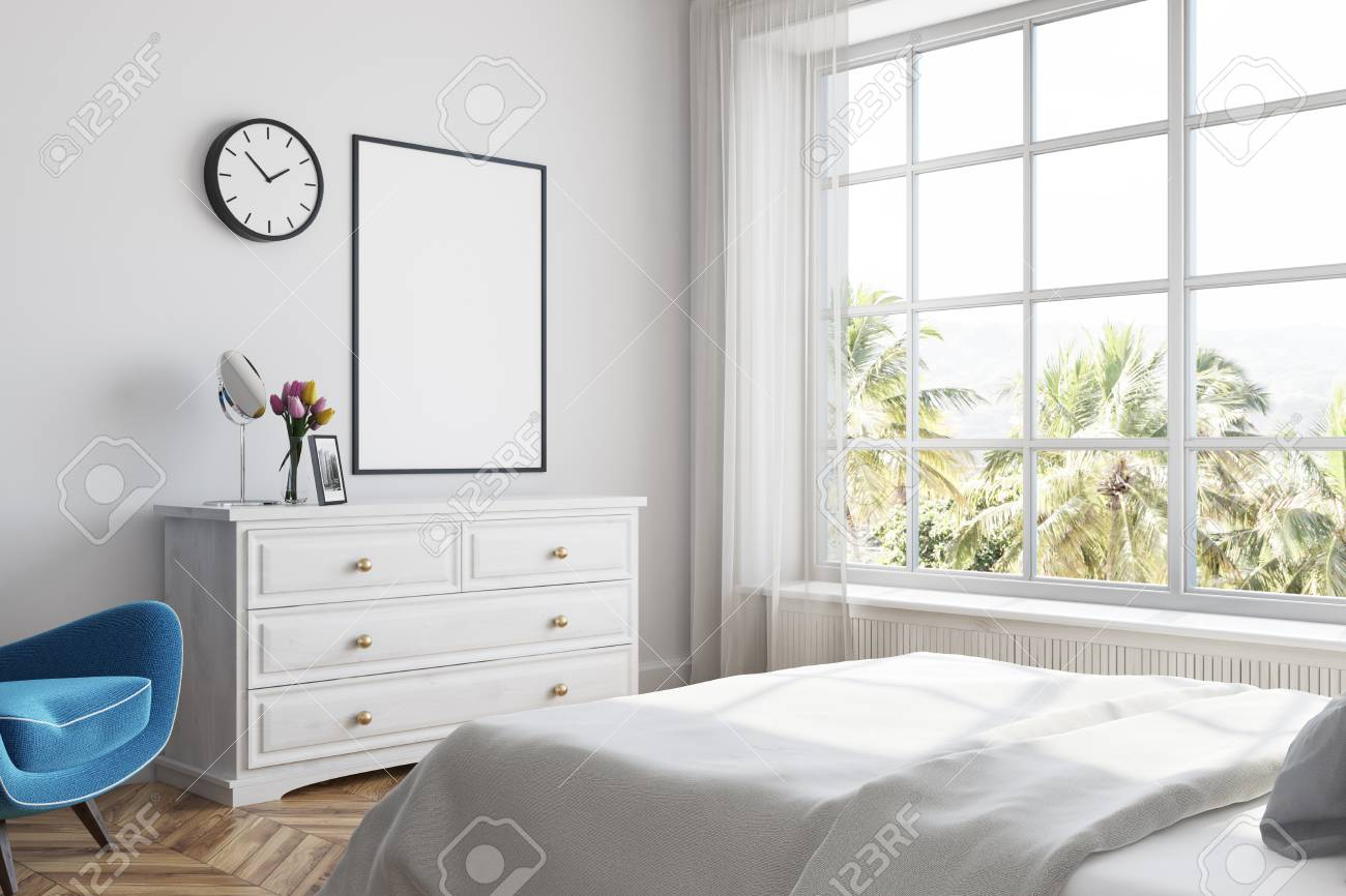 White Bedroom Corner With A White Bed, A Set Of Drawers And A ...
