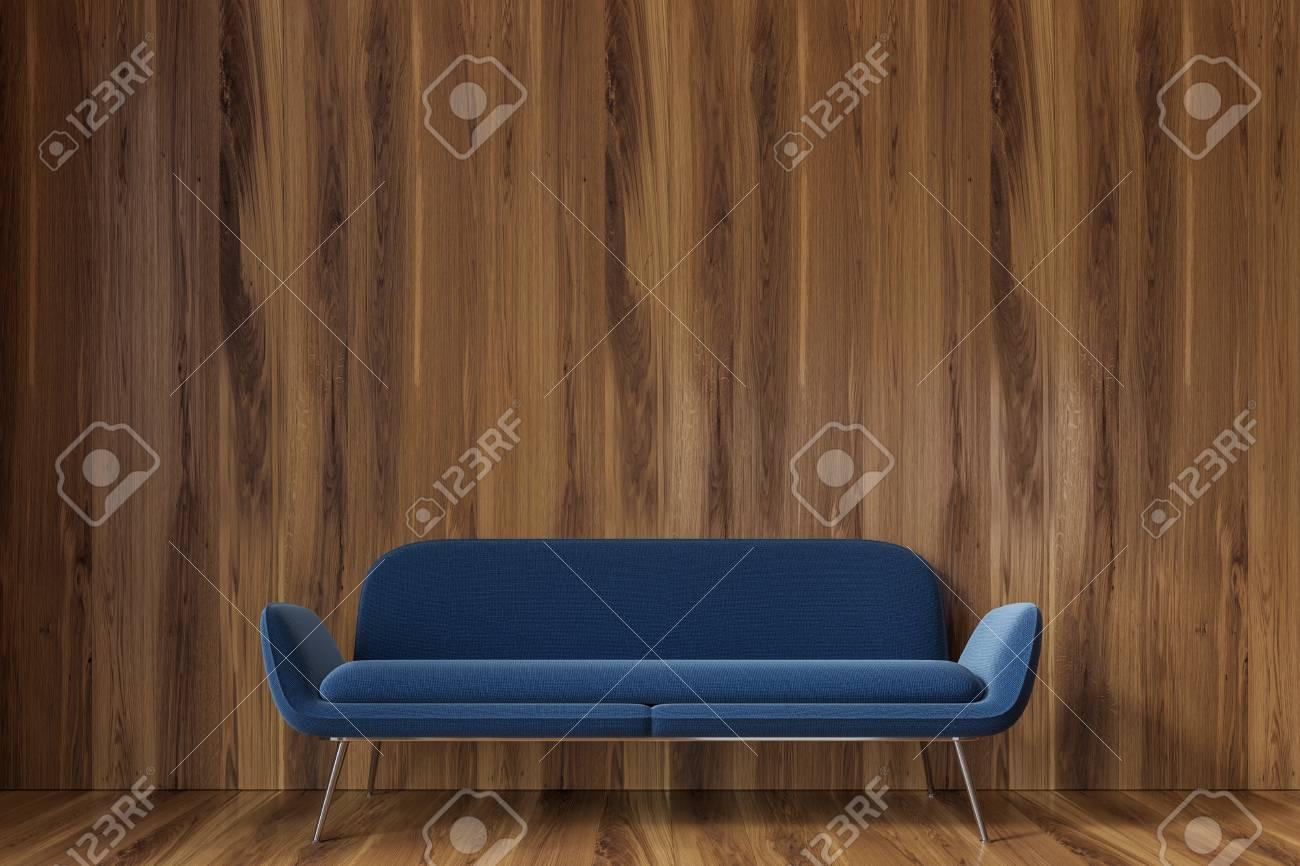 Superb Wooden Empty Room Interior With A Dark Blue Sofa Standing On Evergreenethics Interior Chair Design Evergreenethicsorg