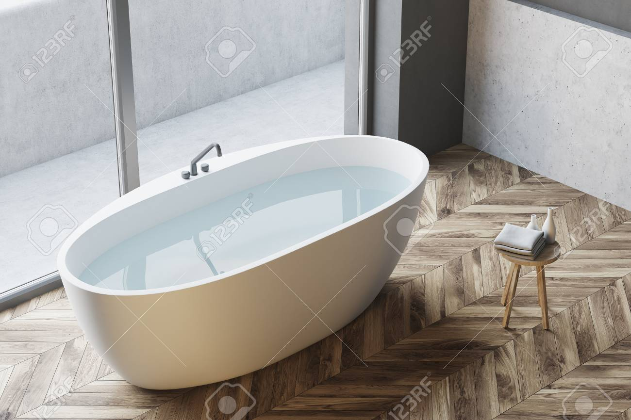 Top View Of A White Bathtub With Water Standing On A Wooden Floor ...