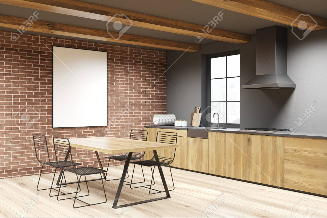 Brick and concrete dining room corner with a wooden table, metal..