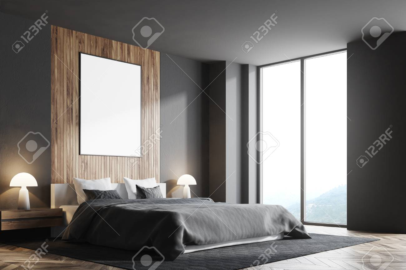 Side view of a gray and dark wooden bedroom with a vertical poster..