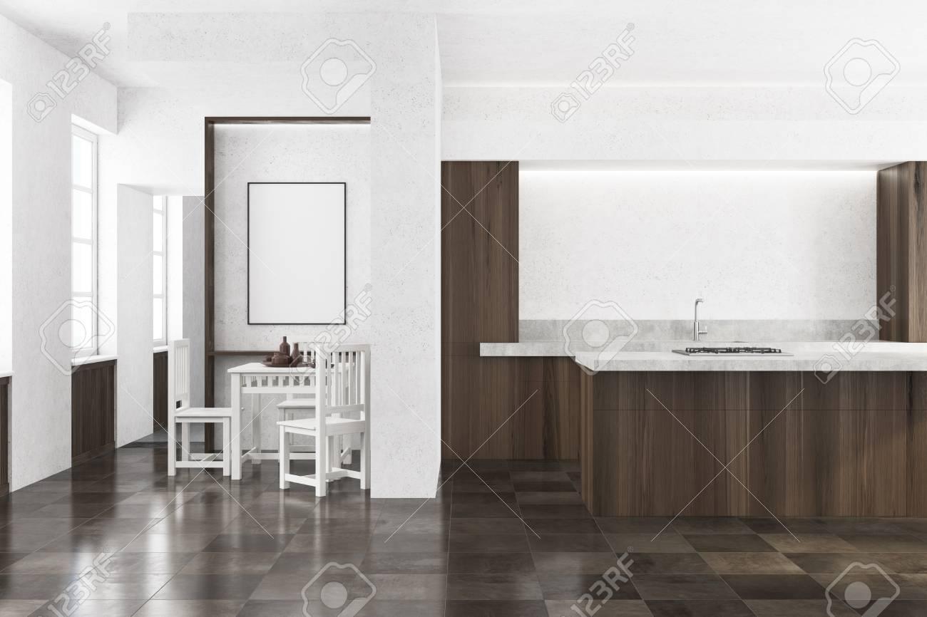 White Kitchen Interior With A Dark Wooden Floor And Dark Wooden