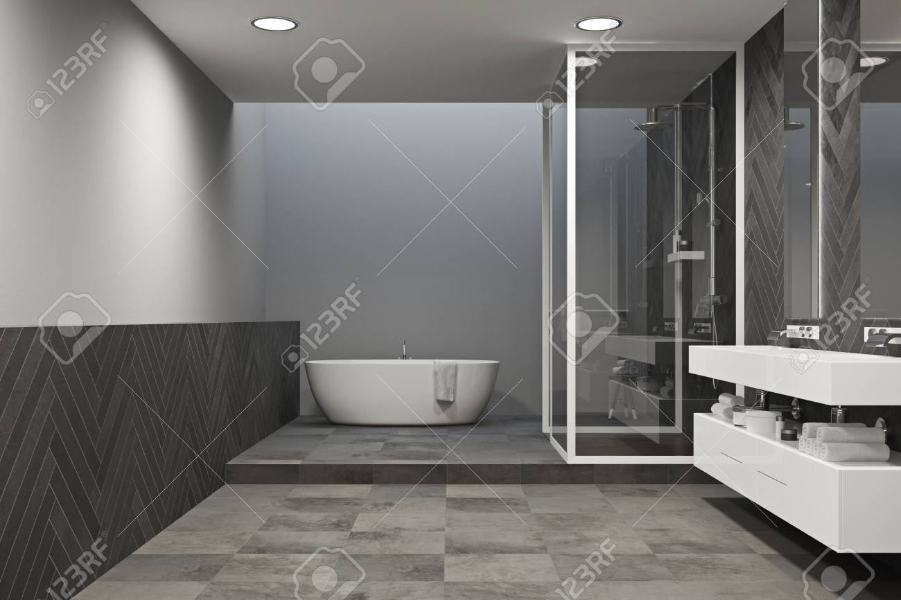 Interior Of A Gray Bathroom With A Tied Floor A White Tub And Stock Photo Picture And Royalty Free Image Image 95655478