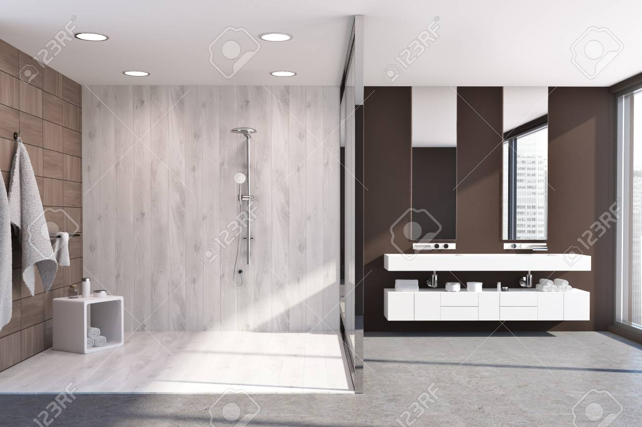 . Panoramic modern bathroom interior with a dark wooden and glass