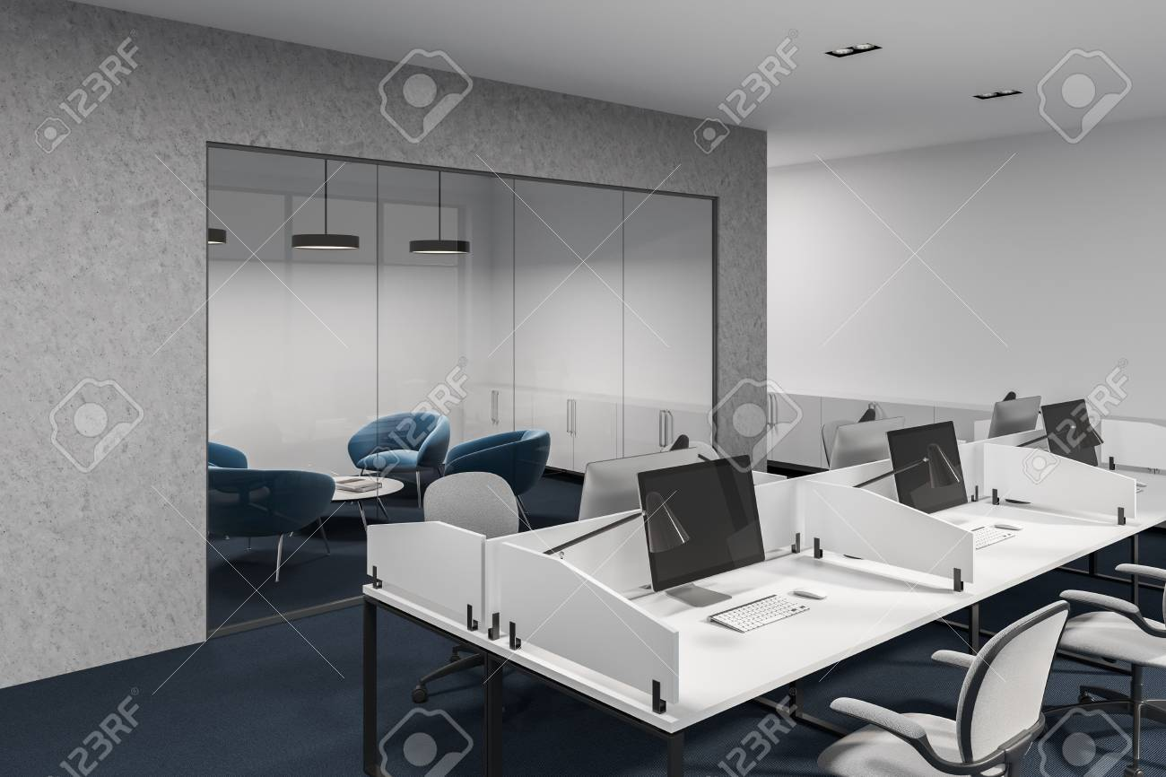 large white office desk. Stock Photo - White And Concrete Office Cubicles With Computer Desks Inside. Chairs Large Windows. A Side View. Close Up. Desk
