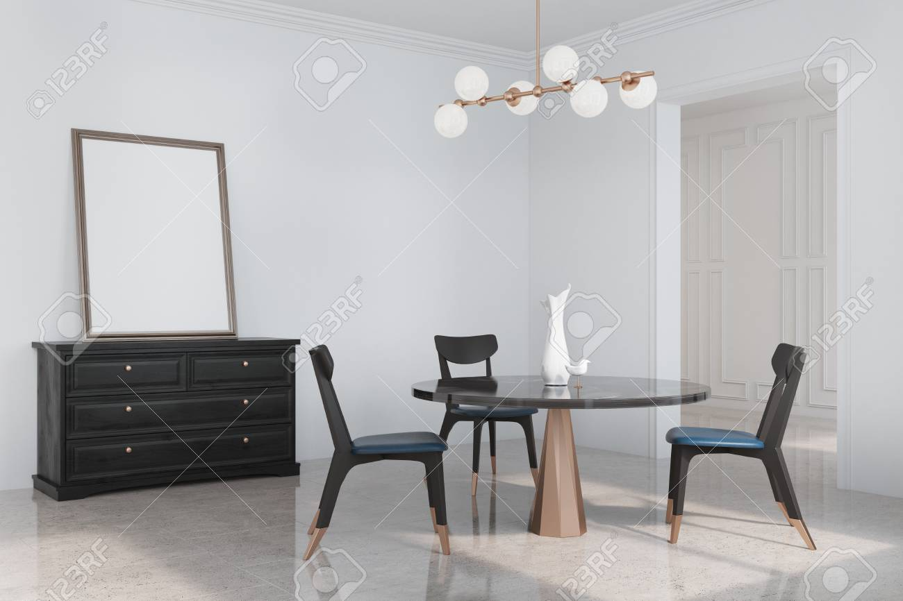 White Dining Room Corner With A Round Black Table Chairs And A
