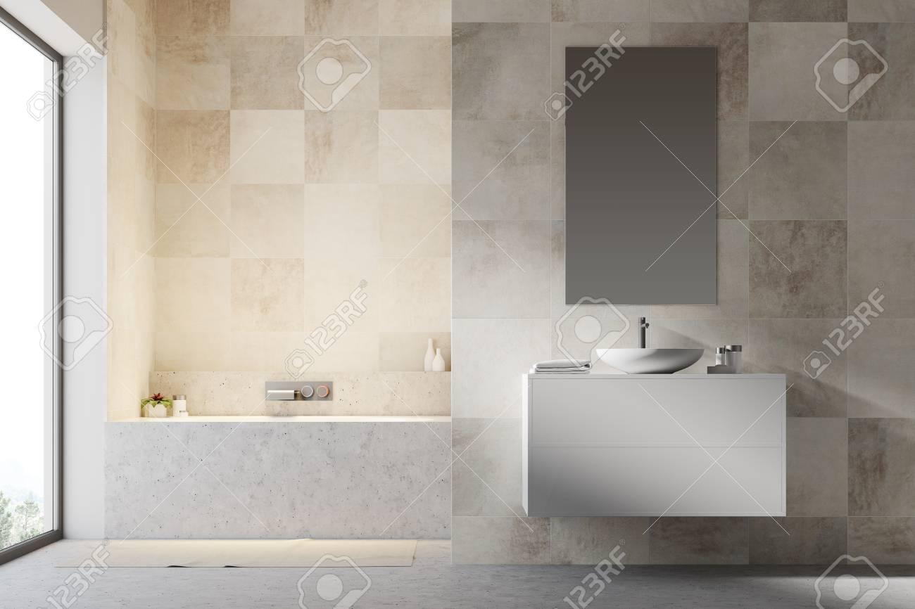 White Tiled Bathroom Interior With A Concrete Floor, A Bathtub ...