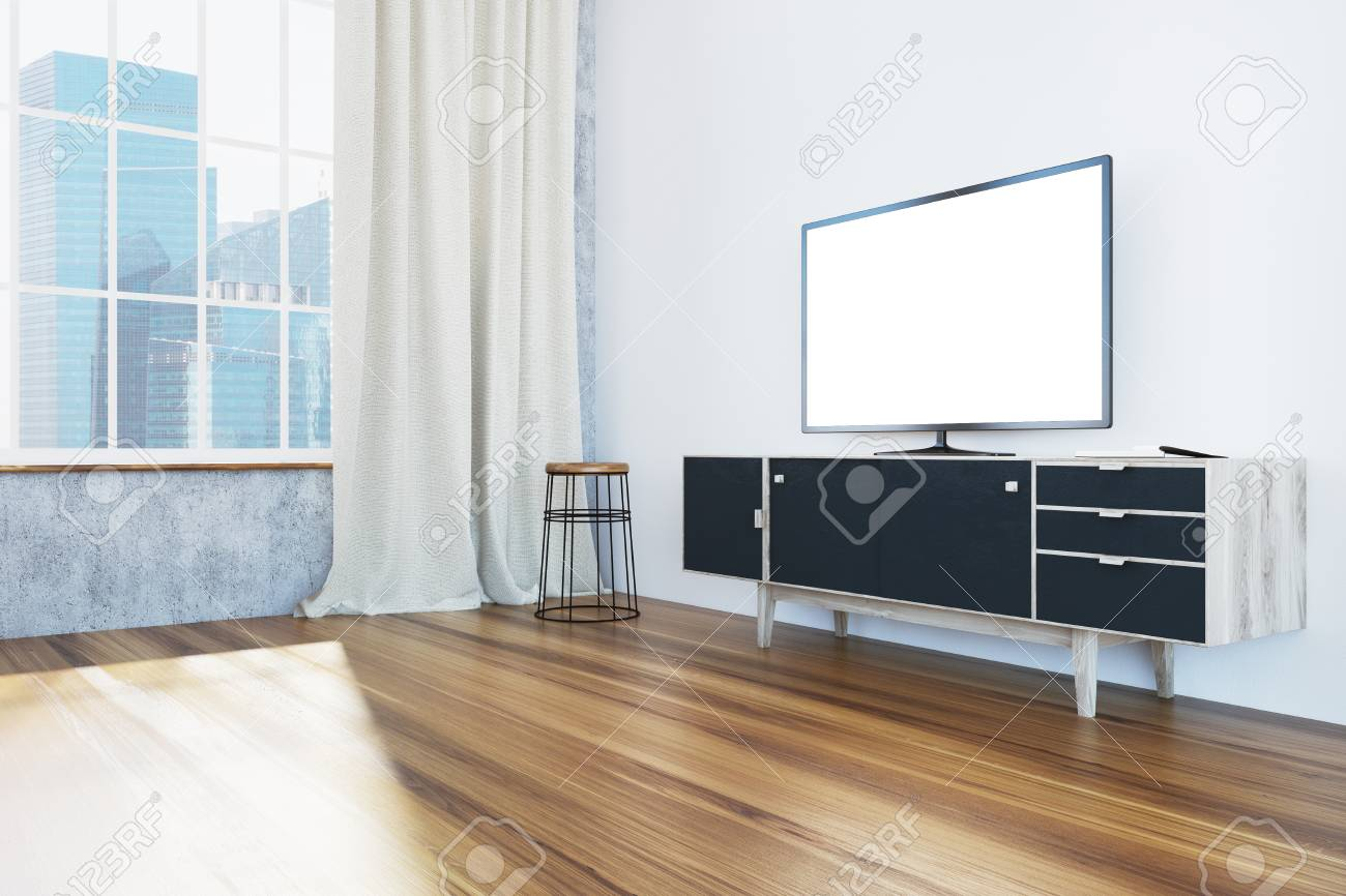 Panoramic white living room corner with a black and wooden cabinet..