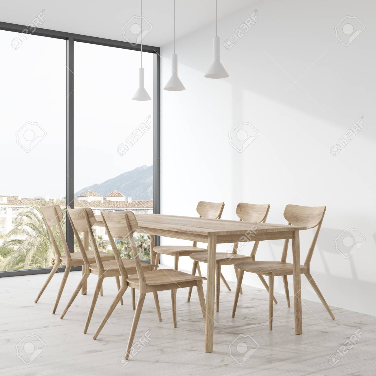 Long wooden dining room table with wooden chairs standing in..