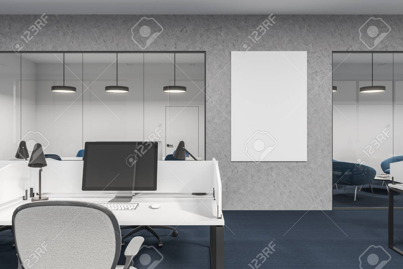 Computer On An Office Cubicle Desk Gray And Glass Walls With