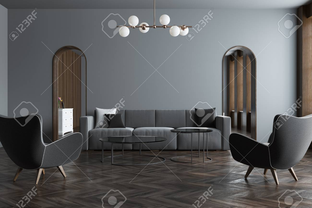 Modern Gray Living Room Interior With A Gray Sofa, Narrow Doorways And A  Wooden Floor